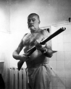 Ernest Hemingway photo with gun