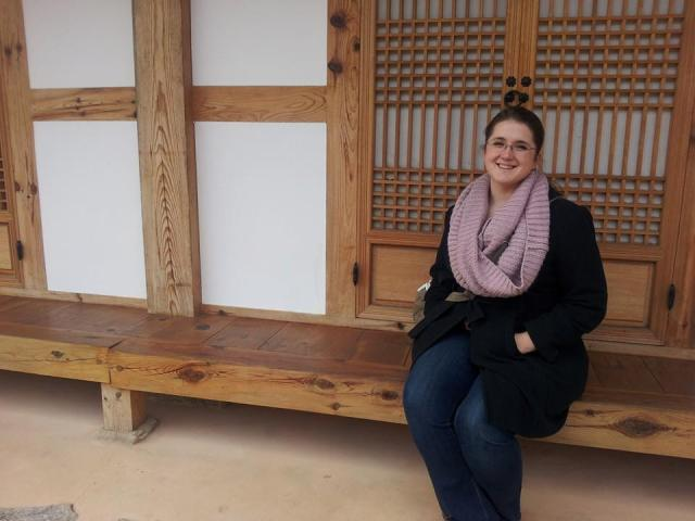 My sister chilling out in front of a traditional tea house in Gongju City.