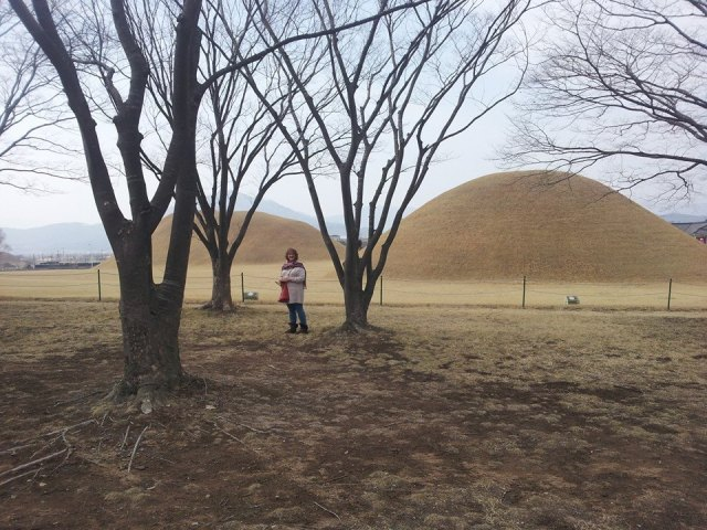 "My mom in the ""Chicken Forest,"" right in front of the Oreung Royal Tombs in Gyeongju City."