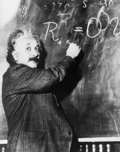 17 Jan 1931, Pasadena, California, USA --- Theoretical physicist Albert Einstein writes a complicated equation on a blackboard. He is at the California Institute of Technology for a lecture being given by Swedish astronomer Dr. Gustave Stromberg. --- Image by © Bettmann/CORBIS