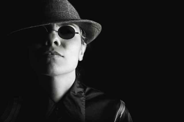 person-sunglasses-dark-hat